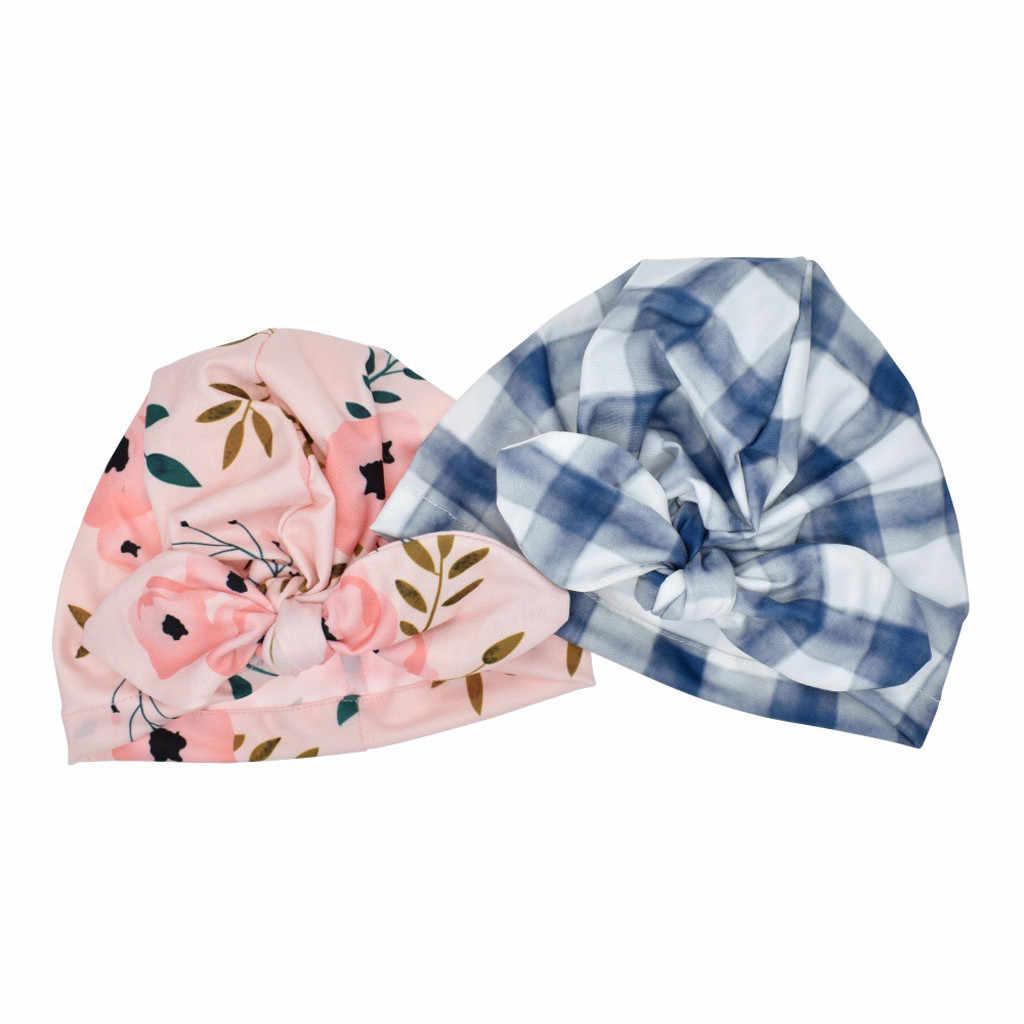 新生児の少年少女のベビー太陽の帽子花柄ちょうキャップ幼児ターバン写真の小道具