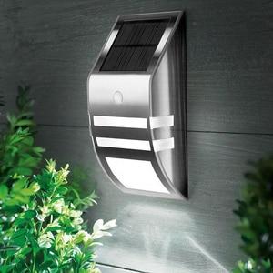 Image 2 - 2pcs Waterproof IP65 Solar light Outdoor Garden Security Led Solar Powered Panel Lamp Wall Lampada PIR Motion Sensor Decorative