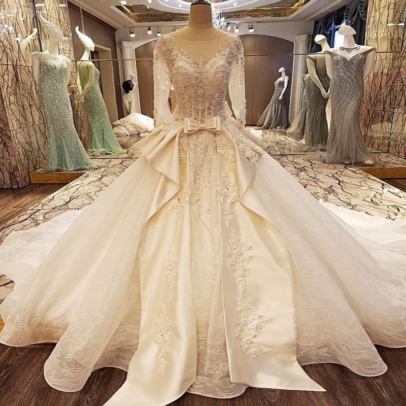 Top Design Sleeveless Sexy Lace Designer Wedding Dresses Luxury Princess Bridal  Dress Crystal Pearls 2018 Vestido De Noiva 1cd7a19b63ce