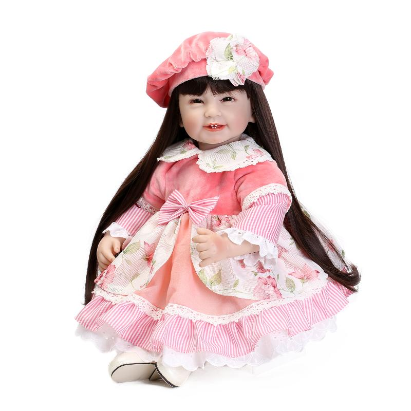 цены Silicone vinyl princess doll toy for girl lifelike smile toddler dolls with pink dress long hair play house toy collectable doll