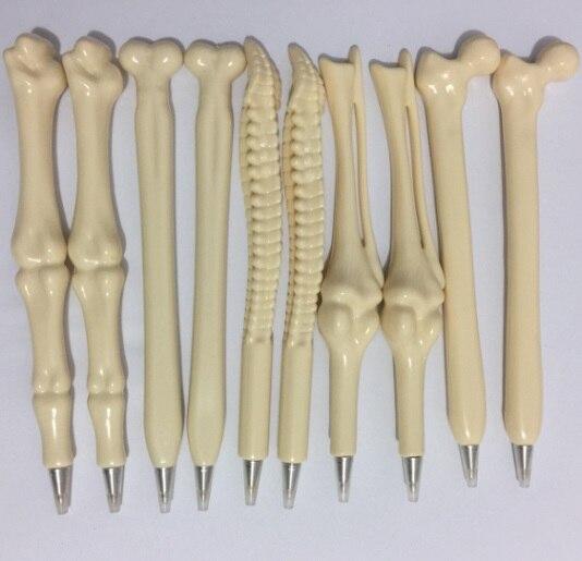 100 pcs lot Syringe Pen Writing Supplies Bone shape ballpoint pens Wholesale New creative gift school