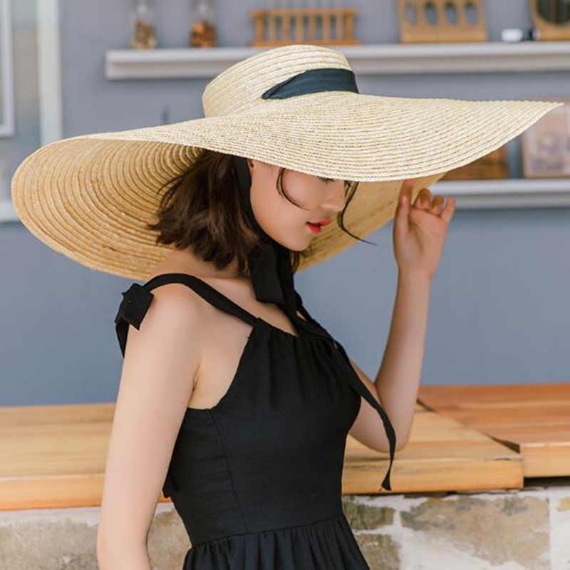 2019 נשים טבעי רפיה קש כובע עניבת סרט 15 cm שולי כובע דרבי חוף שמש כובע כובע קיץ רחב שוליים UV להגן על כובעי נקבה R6