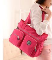 JINQIAOER SELL Fashion women's waterproof nylon handbag with shoulder bag and shoulder RED bag leisure bag.