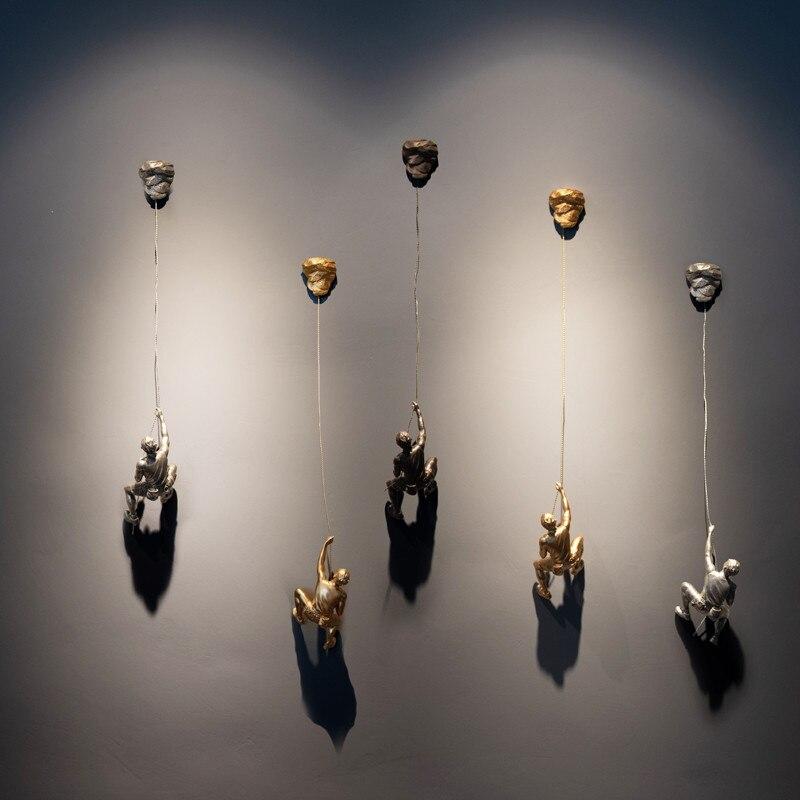 Ev ve Bahçe'ten Statü ve Heykelleri'de Yeni Varış Modern Minimalist Karakter Kaya Tırmanma Adam Kaya Duvar Asma Duvar Asma Dekoratif El Sanatları En Iyi Hediye'da  Grup 1