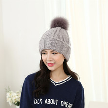 The new knitting wool sweater hat Women thick winter hair ball head cap IGE letters curling warm hat