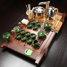 лучшая цена Chinese Style Retro Tea Set Tea Tray Full Set Of Kung Fu Purple Sand Automatic Household Simple Four-in-one Solid Wood Tea Table