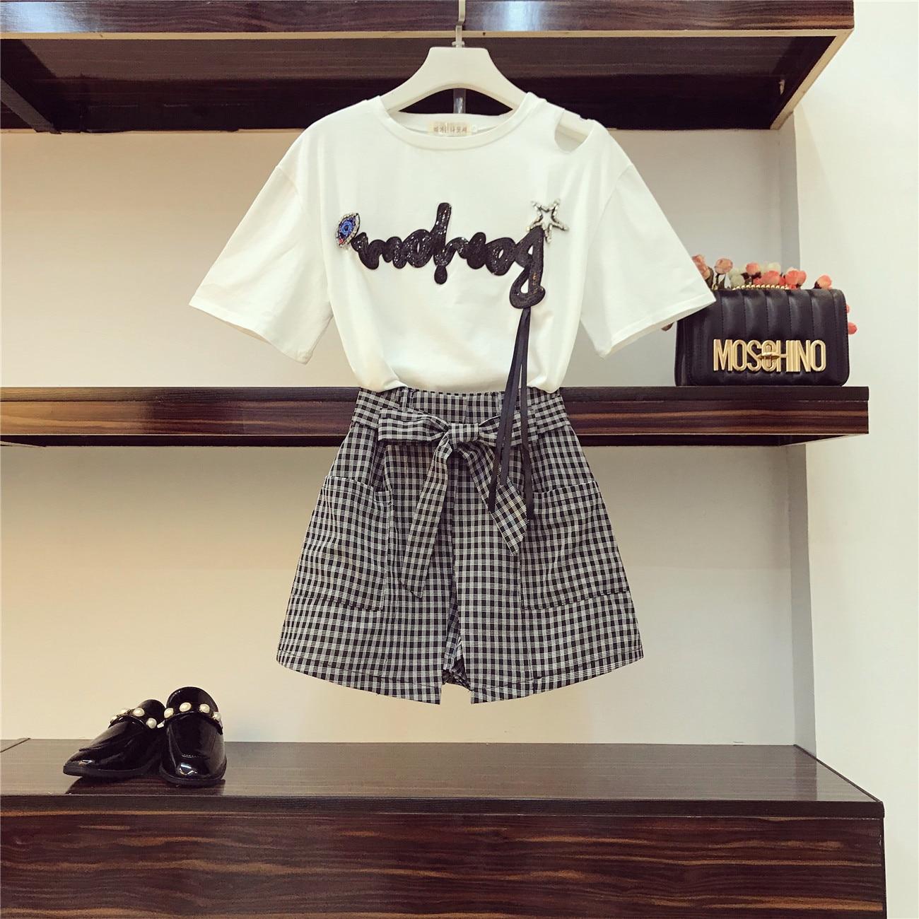 6615b430e 2019 nueva moda verano mujeres estéreo Cisne lentejuelas bordado camiseta  Top + botones rojos una línea falda Twinset señoras falda