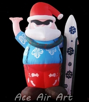 wearing a white shirt Christmas inflatable Chef Santa holding a sack of sugar and whisk, with a rolling pin and towel close at h