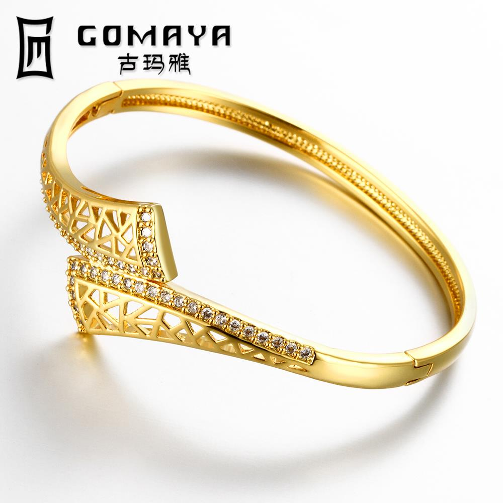 Gold bracelet bangle designs images for Design couchtisch ring