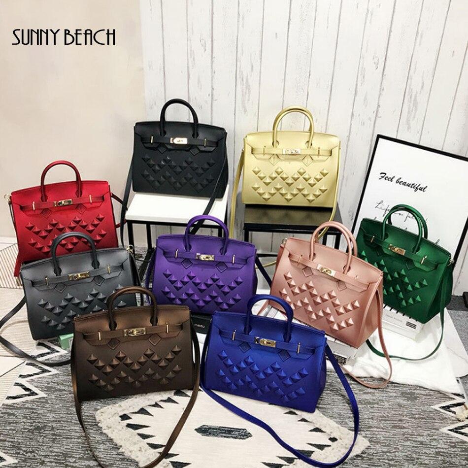 Femme luxe 2019 nouveau Rivet sac à main fourre-tout sac marque Designer sac femmes épaule Messenger PVC mat gelée sac ponçage femmes sac