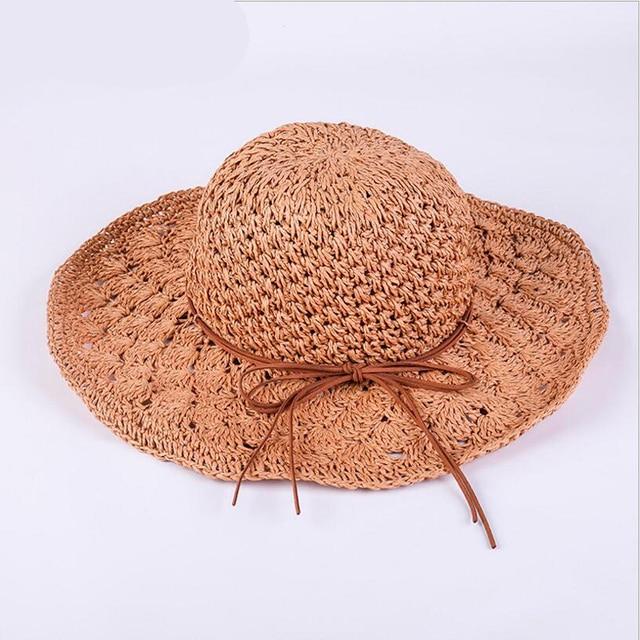 07f490eea25 Hot Handmade Knitted Sun Hat Hollow Out Wide Brim Floppy Straw Hat Bowknot  Fashion Beach Sun Cap Summer Hats For Women