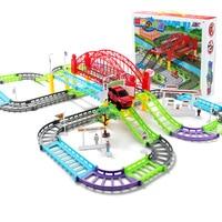 Hijos de luz y sonido de tren tren de juguete coche de carril eléctrico flash de multi-puzzle baby gifts