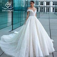 De luxe Hors de Lépaule Robe de Mariée 2020 Swanskirt Sexy Appliques Perlée Robe de Bal Princesse Robe de Mariée Robe de noiva F128