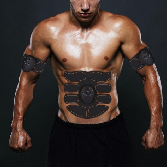 Body building and muscle stimulator with abdominal exercise