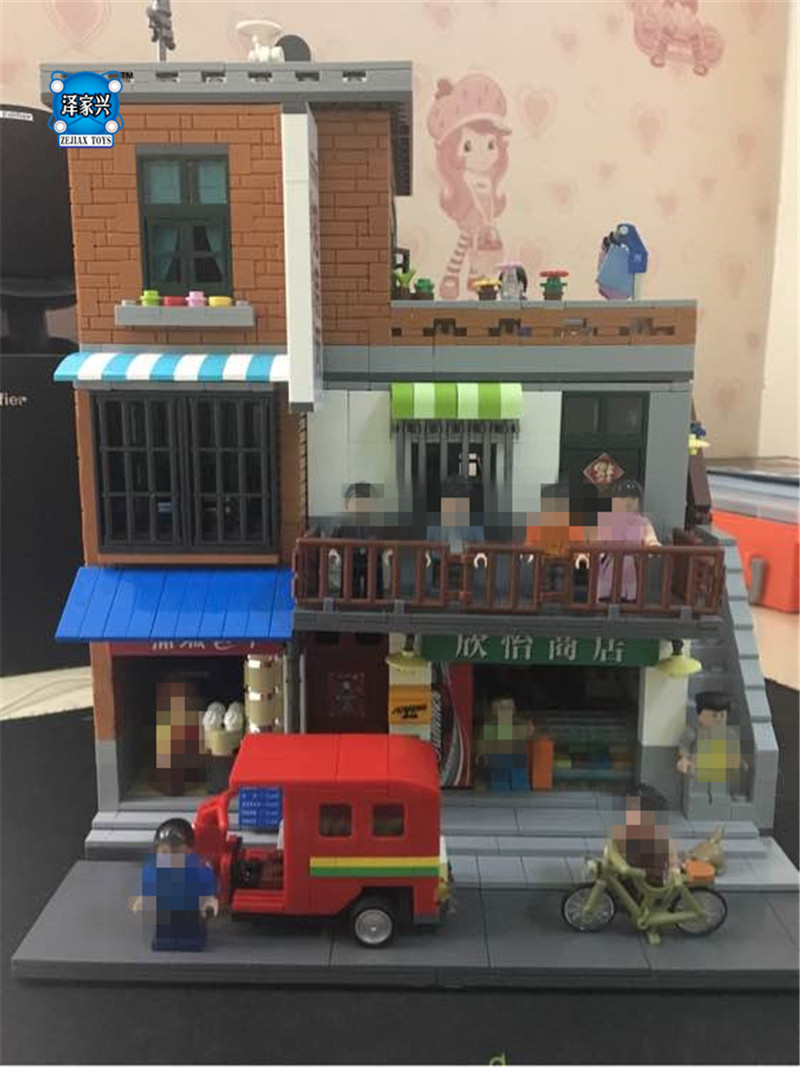 The Urban Village Set 2706 pcs Genuine Creative MOC City Series XingBao Building Blocks Bricks Educational Toys Model Gift xingbao 01001 creative chinese style the chinese silk and satin store 2787pcs set educational building blocks bricks toys model