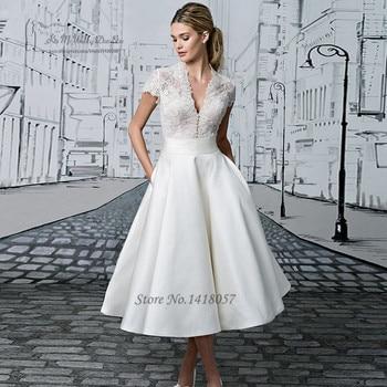 5bae1072b Vestido de novia corto Vintage de encaje de China vestidos de novia baratos  2017 Vestido de novia de manga corta de Curto té longitud vestidos de boda  satén