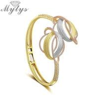 Mytys Fashion Three Tone Gold Geometric Line Cross Charm Bangle Mirco CZ Open Cuff Statement Bracelet Bangles for Women B1119