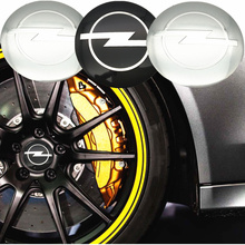 цена на Car Styling 4Pcs Wheel Center Hub Cap Stickers 56.5mm emblems for Opel astra opel astra h astra g insignia Opel mokka car