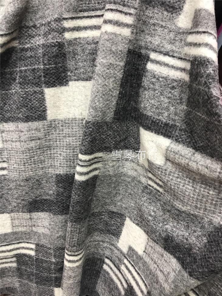 Tissu de laine à tricoter à grille géométrique de couleur noire et blanche et grise