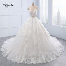 Luxurious Tulle Scoop Ball Gown Wedding Dress Appliques Lace Beading Court Train Illusion Back With Button Liyuke Wedding Gown