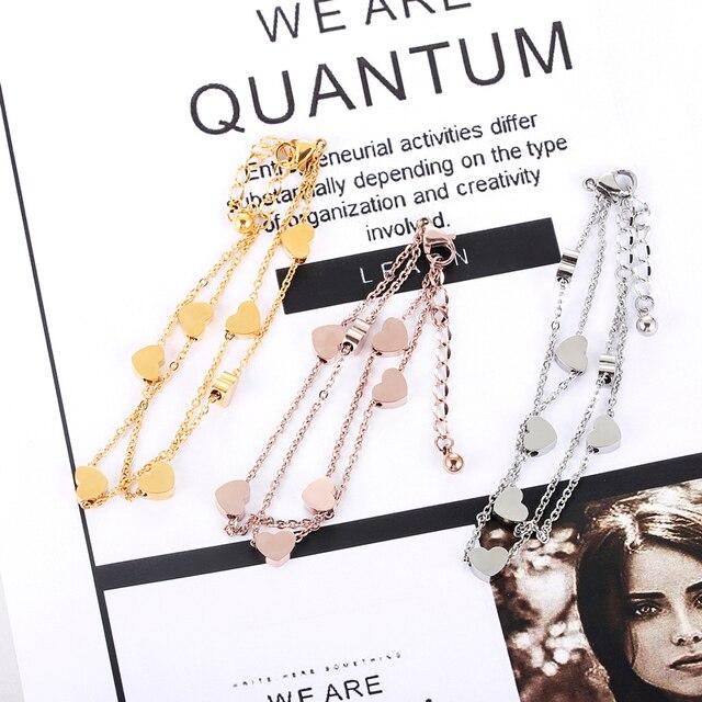 Женский браслет из титановой стали золотого цвета с двойной