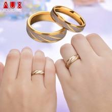 918043b0d185 Auxauxme de acero de titanio amantes pareja anillos de oro de la onda  patrón de la boda anillo de promesa para los hombres y las.