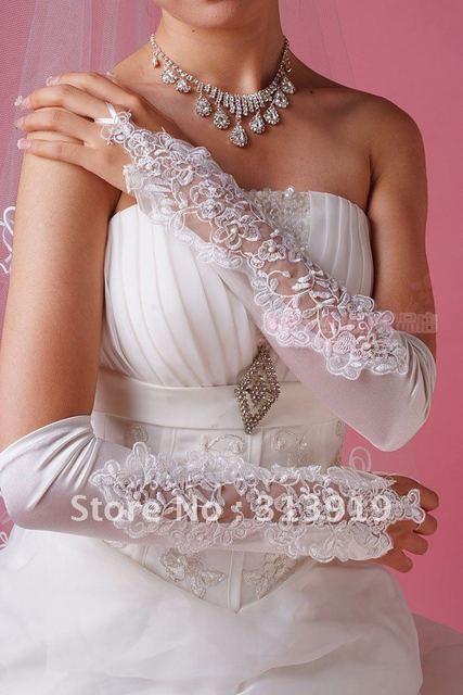 O envio gratuito de casamento luvas sem dedos de noiva com atacadores