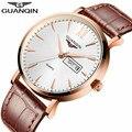 Marca guanqin hombres reloj 2017 relojes banda de cuero de los hombres de negocios de cuarzo 30 m impermeable auto fecha relojes de pulsera hombres reloj