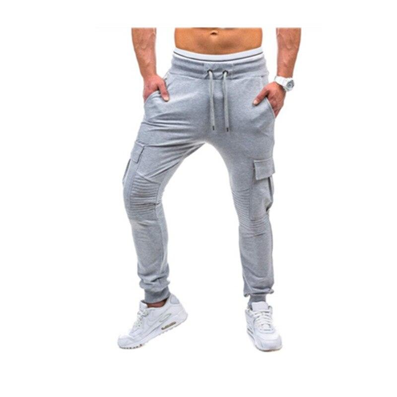 NUOVO 2019 di Autunno della Molla Multi-tasca fascio piede pantaloni uomo Cargo strentch pantaloni della tuta di Fitness pantalon homme harem pantaloni