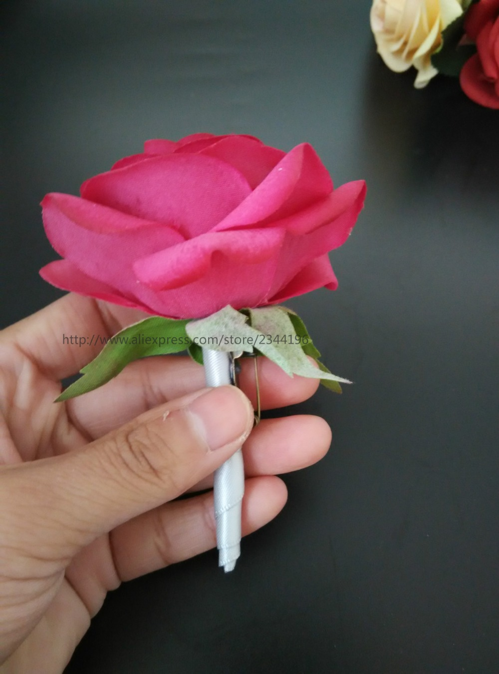 Artificial Shocking Pink Rose Boutonnieres Tied With Silver Ribbon