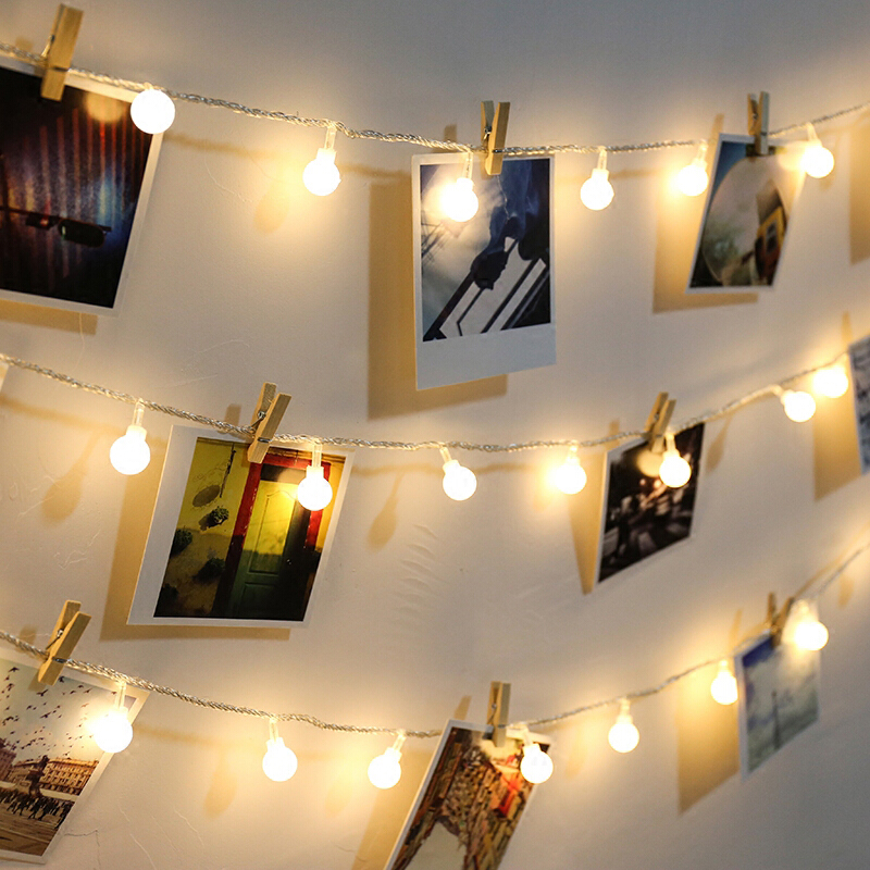 Photo collage clips string lights wall hanging photo wall - How to hang string lights on wall ...