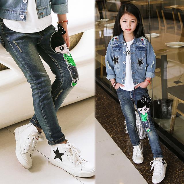 El Nuevo Año, primavera y otoño ropa para niños casual jeans pantalones, imagen de la historieta niñas jeans de moda chica jeans rasgados.