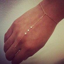 fe4bf94fadea Pulsera de cadena Simple dedo cristalino del grano cadena de moda borla cadena  mano arnés pulsera y brazalete para las mujeres j.