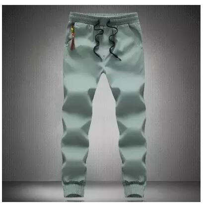 Плюс размер 5XL мужские брюки повседневная мода Тонкий хлопок мужские брюки ноги Харлан брюки мужчины