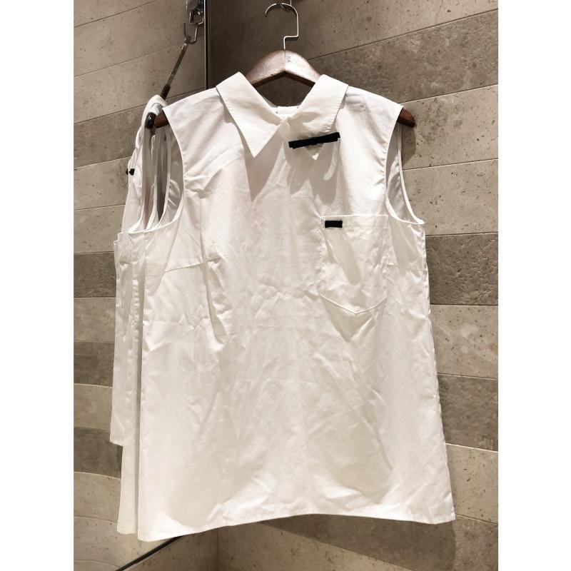 103c1d48bcdb Camisa blanca sin mangas con solapa con lazo decorado con temperamento  simple 2019 top con botón de ...