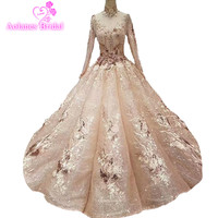 2018 Arabic Dubai Gold Champagne Grid Yarn High Neck Bridal Gowns Backless Waves Ball Gown Princess Illusion Wedding Dresses
