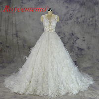 2017 hot sale special lace Wedding Dress sexy transparent top Bridal gown custom made ball gown skirt with flowers and feathers