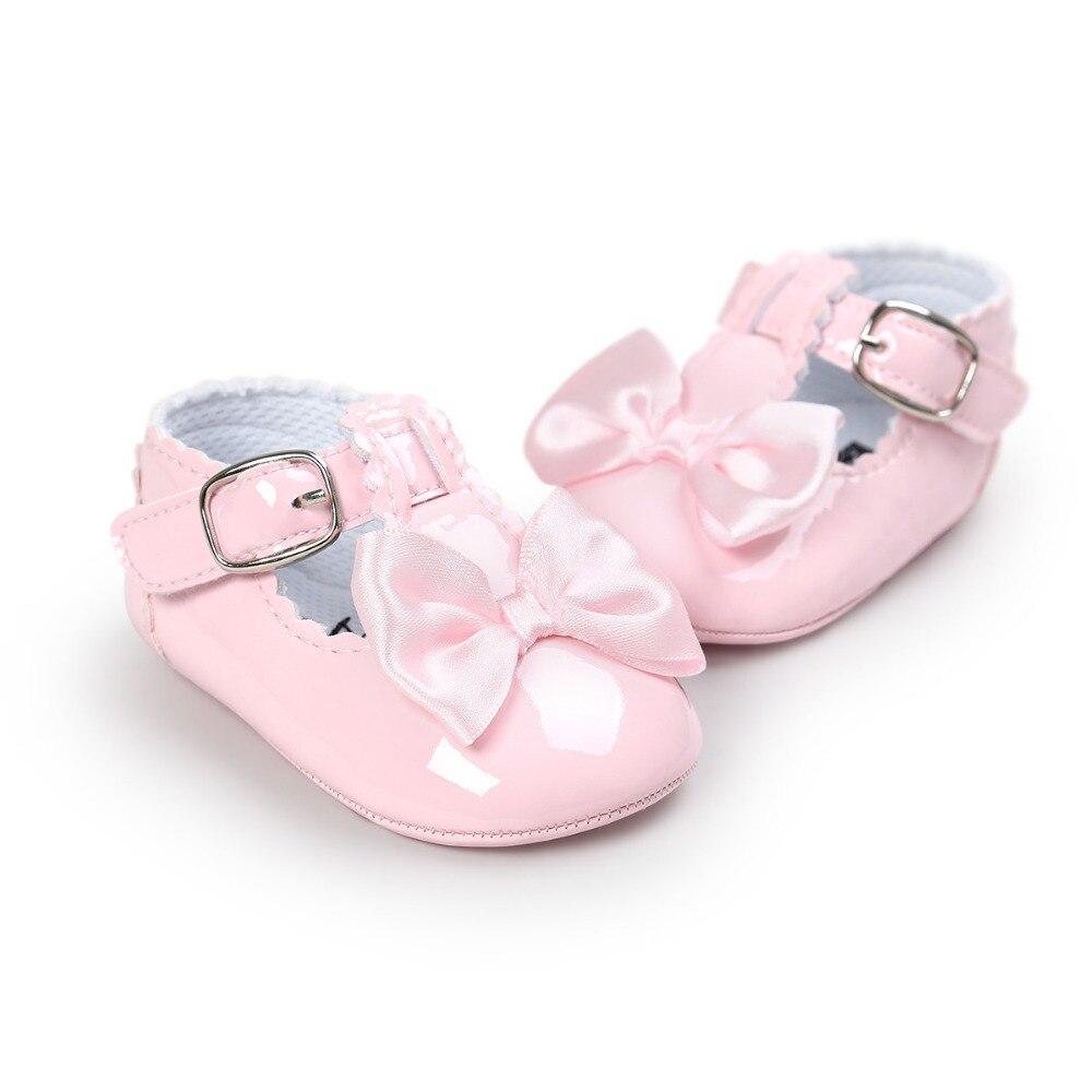 2017 Baby schoenen Romirus gloednieuwe PU lederen meisje jongen Babyschoenen schoenen Zachte Bodem antislip Mode strik Bebe Schoenen CX43C