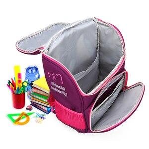 Image 5 - İlköğretim okul çantaları ortopedik sırt çantası kız erkek su geçirmez sırt çantası sevimli baskı yürümeye başlayan sırt çantası mor Mochila Escolar