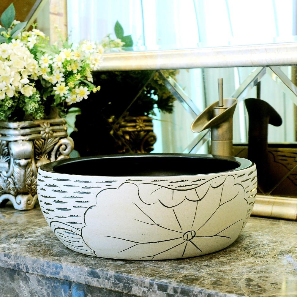 China Artistic Handmade Engraving Ceramic Lavobo Round Countertop round wash basin ceramic (4)