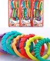 Juguetes para bebés de 0-12 meses Rainbow QQ niños anillo mordedor molares teddy cadena embrague anillo delantal
