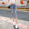 Calças de brim Mulher Venda American Apparel 2016 Verão New Coreano Personalidade Buraco Fino Jeans Calças de Brim Por Atacado das Mulheres Sete do Sexo Feminino