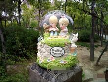 Free Shipping Baby doll Time droplets luminous crystal ball music box