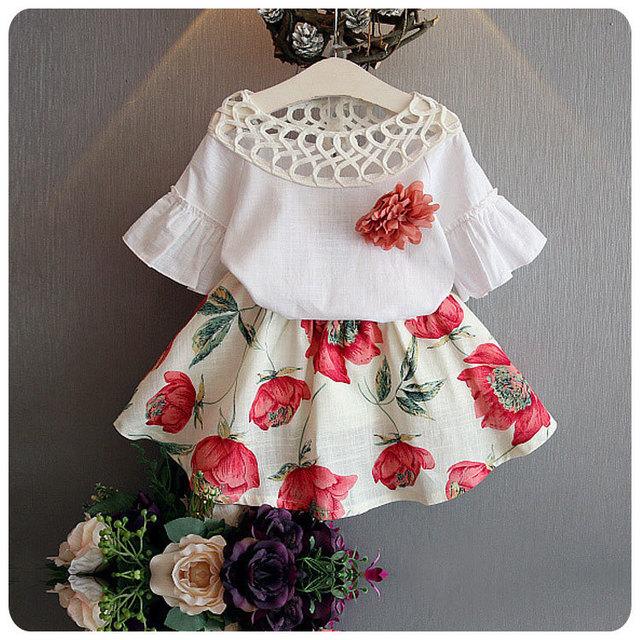 2016 Ropa Del Verano de Los Niños Coreanos 2 Unidades Set Nuevo Patrón muchacha Del Bebé Ahueca Hacia Fuera de Plomo Cuerno Flor Chaqueta de Manga Corta falda