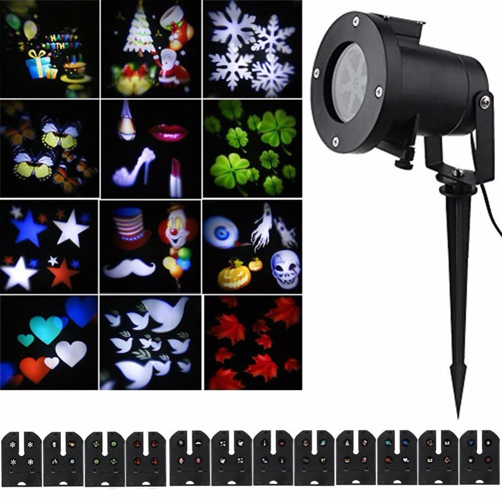 где купить 12 Pattern Lens Replaceable Colorful LED Rotating Laser Projector Lamp Outdoor Garden Christmas Landscape Projection Led Light дешево