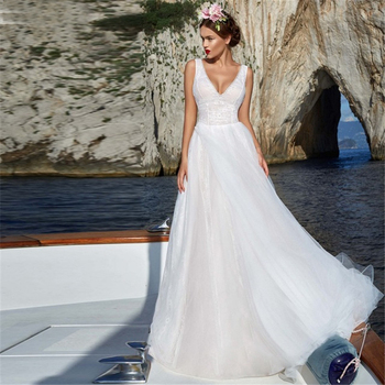 A Line V Neck Backless Tulle Wedding Dress Gorgeous Applique Open Back Wedding Bridal Gowns With Court Train Custom Made
