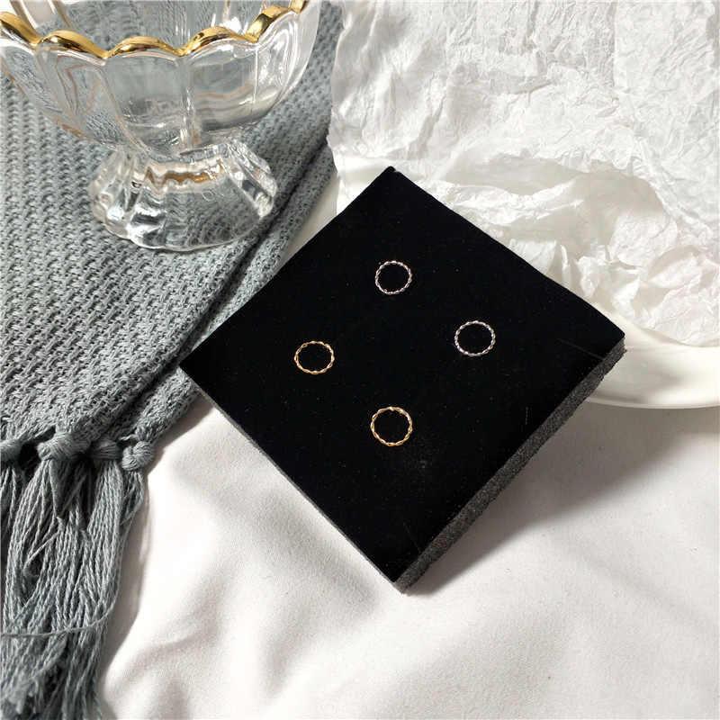 Nuevo minimalista espiral círculo pendientes mujeres oro y plata Metal Stud pendientes temperamento joyería para mujeres amigo regalo