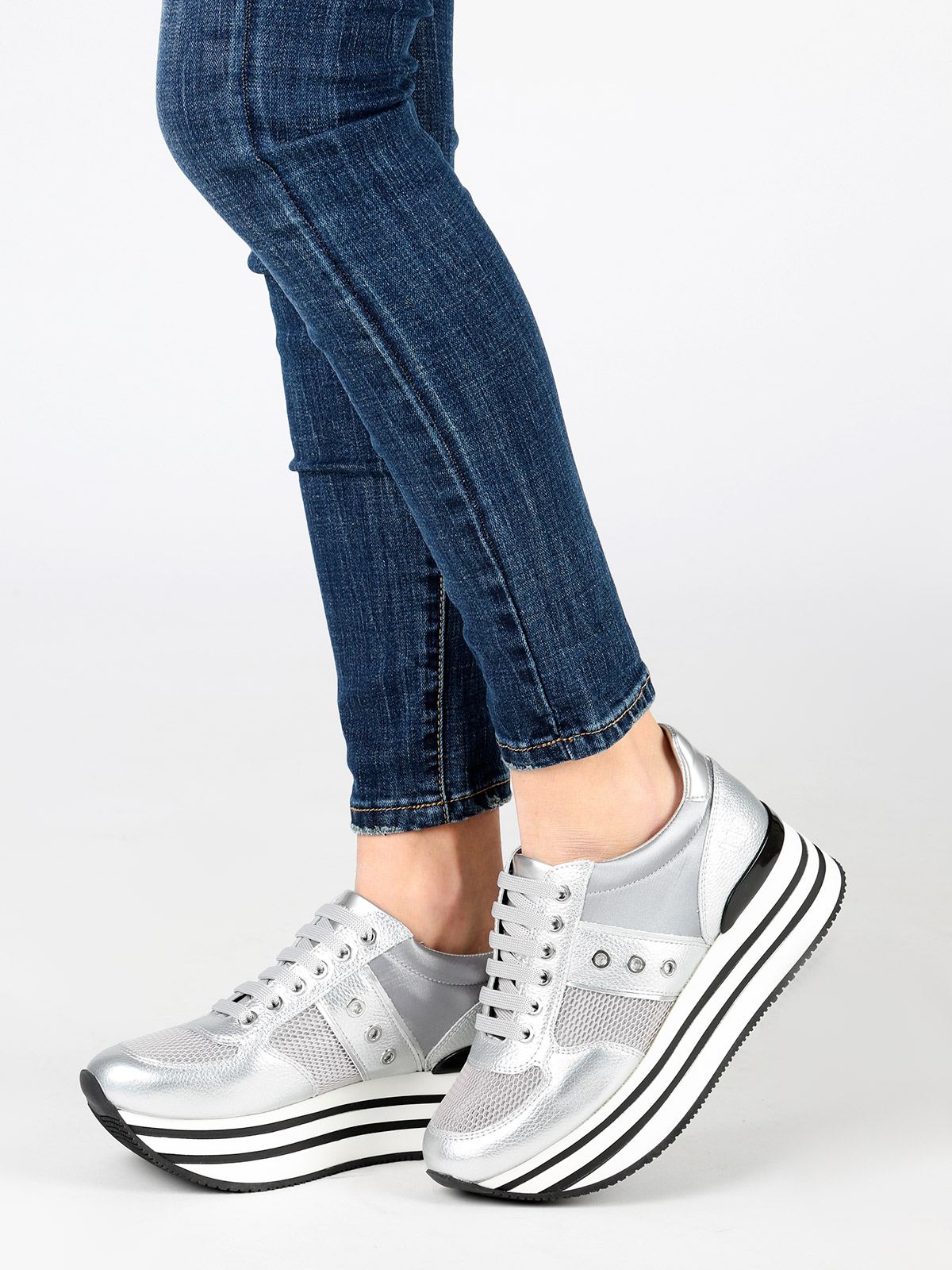 Silver sneakers with high sole
