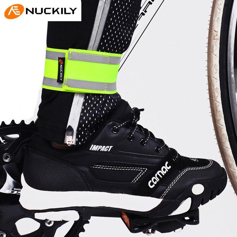 ac09b583b14bb Nuckily advertencia reflexiva Seguridad Leggings elástico Cintas MTB  bicicleta haz Pantalones noche al aire libre deporte Correr montar  calentador de la ...