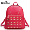 QIAO BAO 2017 Brand women real leather backpack lady rivet backpack, fashion school bag.free shipping